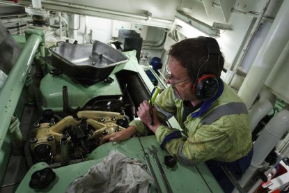 The 2nd Engineer on board an Offshore Oil Platform Supply Vessel (PSV) in the North Sea, in the process of changing a fuel injector.